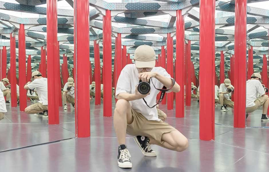 man taking photo in the infinity room