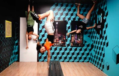 three friends having fun in the rotated room