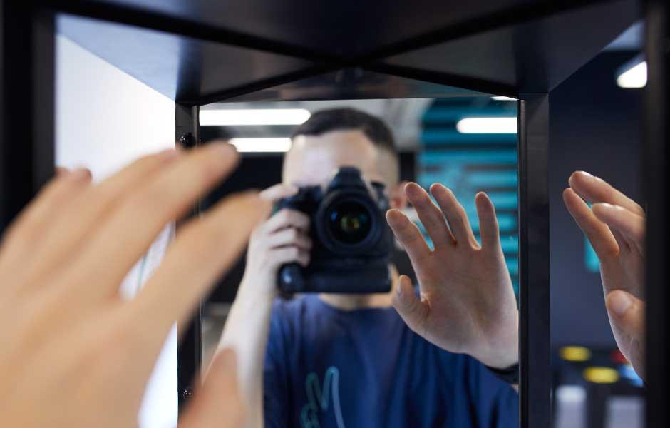 man taking photo of true mirror illusion